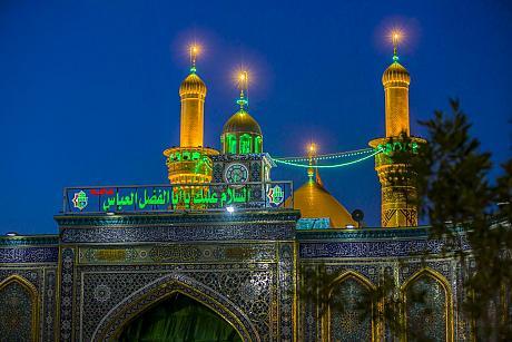 Imam al-Hassan al-Mojtaba and Aba al-Fadl al-Abbas (peace be upon both of them).
